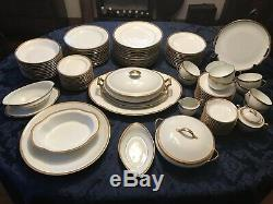 A. Lanternier Limoges white dinnerware set with gold trimvery good condition