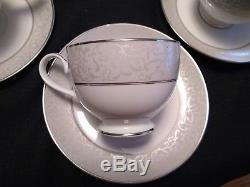 Mikasa China dinnerware (16 place settings)white with silver/gray rim